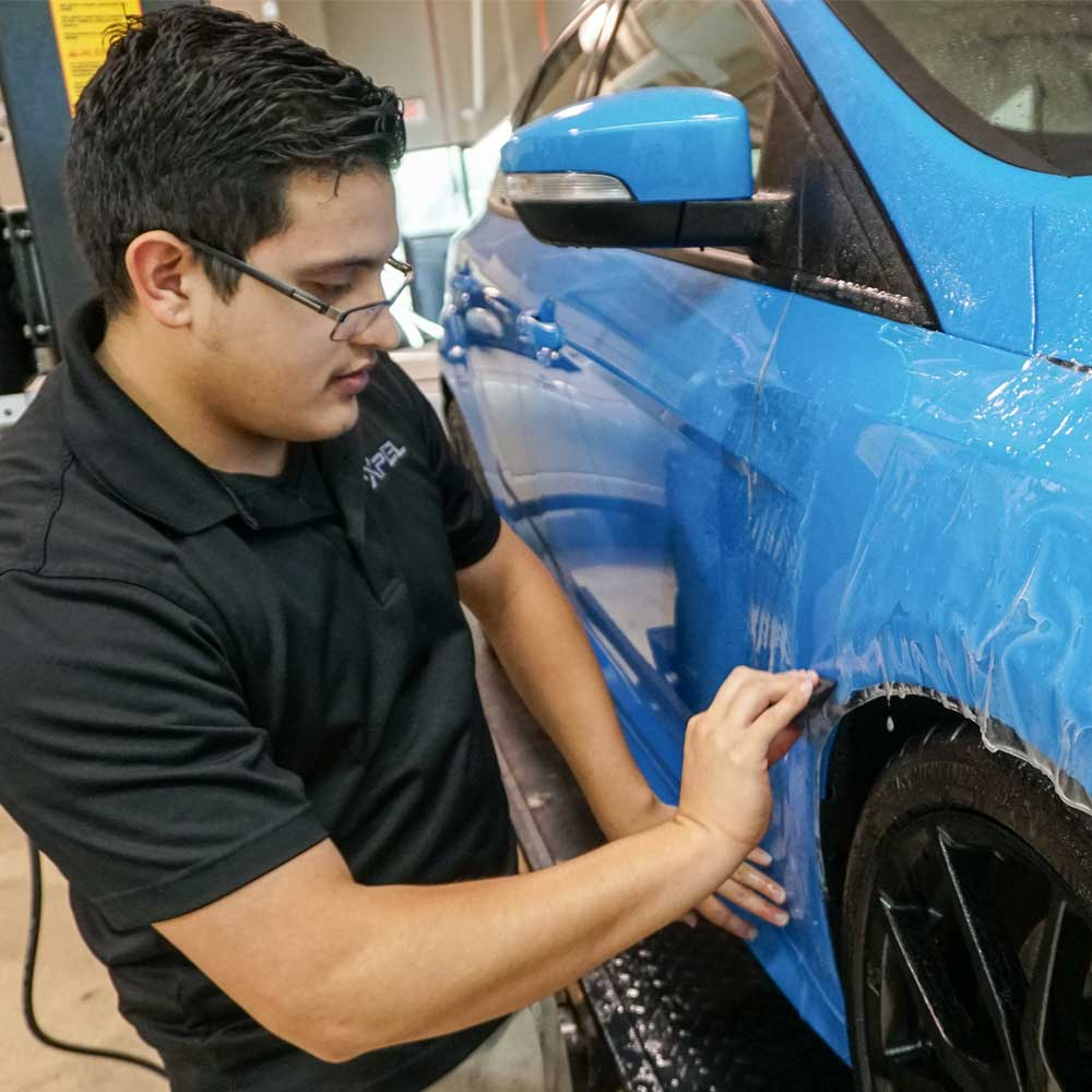 guy-installing-paint-protecion-for-car-in-snellville-ga